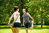 Warm up - couple exercising before jogging — Photo