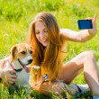 Dog and woman - happy memories — Stock Photo #33099211