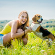 Teenager with her dog — Stock Photo