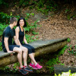 Couple relaxing after jogging — Stock Photo