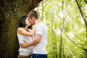 Love - kiss in forest — Stock Photo
