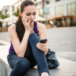 Problems - young woman with phone — Stock Photo