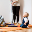Cleaning home - mother with baby — Stock Photo