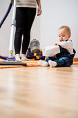 Cleaning home - mother and child — Stock Photo