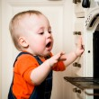 Unguarded baby with open oven — Stock Photo #45078877
