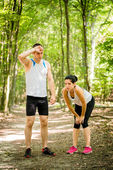 Couple relaxes after jogging — Stock Photo
