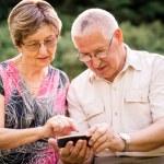Senior couple with smartphone — Stock Photo #51090409