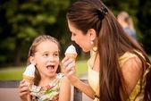Mother and child enjoying icecream — Stock Photo