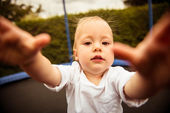 Baby trying to catch camera — Stock Photo