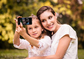 Mother with child selfie — Stock Photo