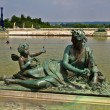 Sculptures and pond of Royal residence at Versailles near Paris in France — Stock Photo #13976963