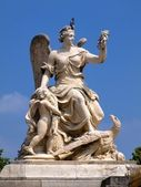 Marble sculpture at the facade of Versailles palace — Stock Photo