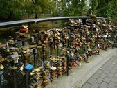 Love locks in Riga representing secure friendship and romance — Stock Photo