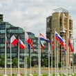 Vilnius city skyscrapers and European Union flags. — Stock Photo