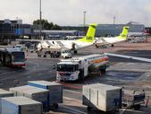 Air Baltic airplanes in Riga airport. Air Baltic is the Latvian flag carrier airline and a low-cost carrier — Stock Photo