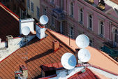 Satellite dish on the roof of a house with clipping paths  — Stock Photo