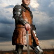 Knight holding his sword — Stock Photo