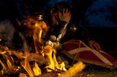 Knight near the fire — Stock Photo
