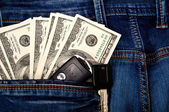 Cash and key from the car in pocket — Stock Photo