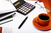 Calculator,pen, notebook and business reports. Coffee Break — Stock Photo