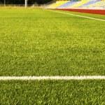Green football field grass. Stadium — Stock Photo #49751171