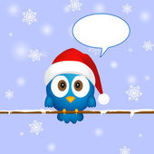 Cute blue christmas bird with speech bubble — Stock Vector