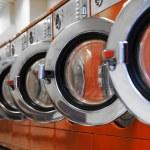 Row of washing machines in laundromat — Stock Photo #17739021