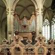 Angels and the great organ of the church of St Nicolas Genth Belgium - 图库照片