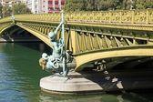 Mirabeau bridge, woman allegory 19 th century (Paris France) — Stock Photo