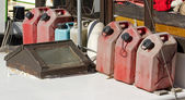 Jerry cans of fuel, reserve on a boat — Stock Photo