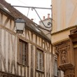 City of Auxerre, medieval decoration in the angle of a street  Burgundy - Stockfoto
