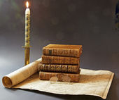 Old books and map of 17 th century, enlightened in the candle — Stock Photo
