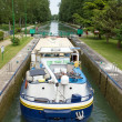 Barge, passage of a lock (France) — Stock Photo