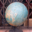 Globe on sale at a secondhand goods dealer (France) — Stock Photo