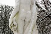 Feminine buttocks under the snow — Stock Photo