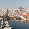 Charles Bridge and Prague Castle at winter - Stock Photo