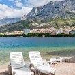 Beach chairs, Makarska, Croatia — Stock Photo #21293125