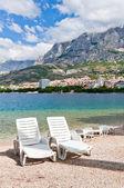 Beach chairs, Makarska, Croatia — Stock Photo