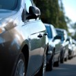 Stock Photo: Row of parked cars