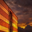 Stock Photo: Office building at sunset