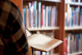 Person in library — Stock Photo