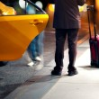 Masn catching a taxi — Stock Photo #14058617