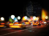 Blurred yellow cabs — Stock Photo