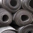 Rolls of black foam - Stock Photo