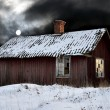 Stock Photo: Old shack in winter evening