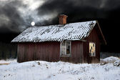 Old shack in winter evening — Stock Photo