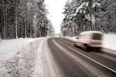White van on winter road — Stock Photo