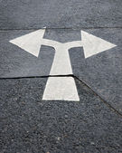 Arrow sign on asphalt — Stock Photo