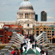 Saint pauls cathedral and millennium bridge — Stock Photo