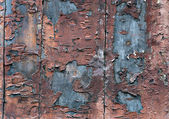 Wooden wall with flaking paint — Stock Photo